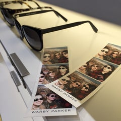 Photo taken at Warby Parker - Puck Store by Jessica W. on 12/6/2014
