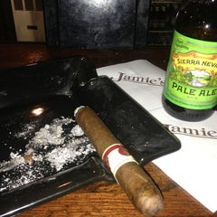 Photo taken at Jamie's Cigar Bar & Restaurant by Peter B. on 1/16/2013