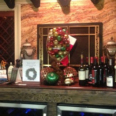 Photo taken at Jamie's Cigar Bar & Restaurant by Peter B. on 12/21/2012