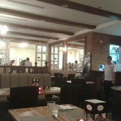 Photo taken at Kaffa Kafe by Alice L. on 10/27/2012