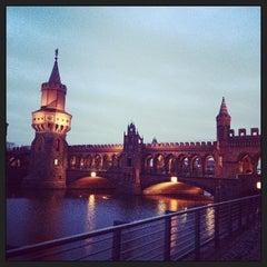 Photo taken at Oberbaumbrücke by Ira K. on 1/1/2013