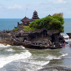 Photo taken at Tanah Lot Beach by Taben N. on 10/28/2012