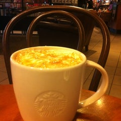 Photo taken at Starbucks by Tan on 12/4/2012