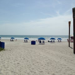Photo taken at Cocoa Beach by Lauren S. on 6/21/2013