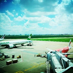 Photo taken at Tan Son Nhat International Airport (SGN) Sân Bay Quốc Tế Tân Sơn Nhất by emily l. on 7/12/2013