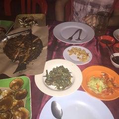 Photo taken at Jimbaran Beach Cafe by Julia on 9/11/2015