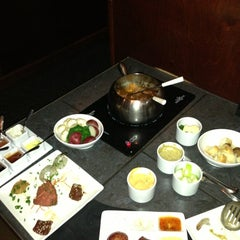 Photo taken at The Melting Pot by Nick R. on 1/14/2013