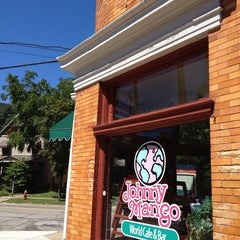 Photo taken at Johnny Mango World Café & Bar by Allen H. on 7/25/2013