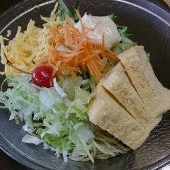 Photo taken at 京都ラーメン春陽堂 つかしん店 by Izumi T. on 6/3/2014