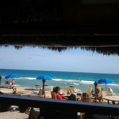 Photo taken at Bamboo Beach Tiki Bar & Cafe by Deilyn M. on 12/24/2012