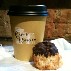 Photo taken at Caffè Umbria by Kerry M. on 10/31/2012