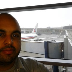 Photo taken at Gate 31 by Vladimir A. on 6/3/2013
