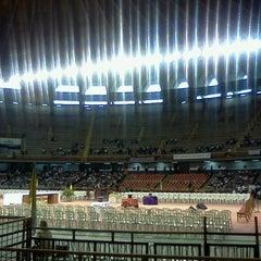 Photo taken at Estádio Jornalista Felipe Drummond (Mineirinho) by Nicole R. on 3/28/2013