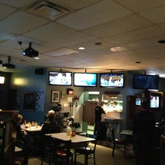 Photo taken at Coaches Bar and Grill by John M. on 12/20/2012
