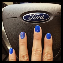 Photo taken at Dana Ford Lincoln by Elizabeth S. on 6/14/2013