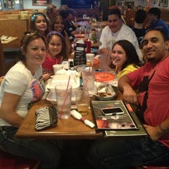 Photo taken at Mike & C's Family Sports Grill by Amanda S. on 4/23/2013