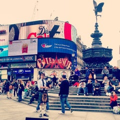 Photo taken at Piccadilly Circus by Наташа Р. on 5/12/2013