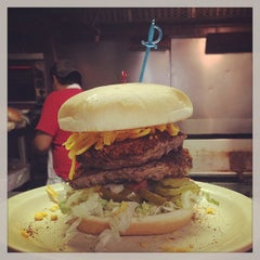 Photo taken at Hut's Hamburgers by Oscar G. on 2/9/2013