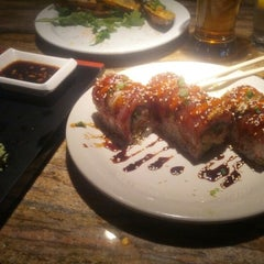 Photo taken at flying fish sushi by Dan W. on 11/10/2012
