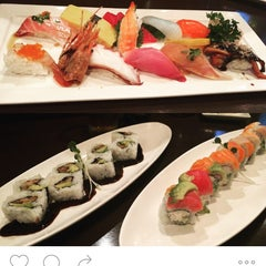 Photo taken at Okura Robata Sushi Bar and Grill by Frau M. on 10/28/2015