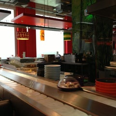 Photo taken at YO! Sushi by Anastasia S. on 5/14/2013