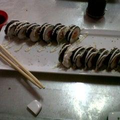 Photo taken at Sushi Kakilima by Desy P. on 12/29/2012