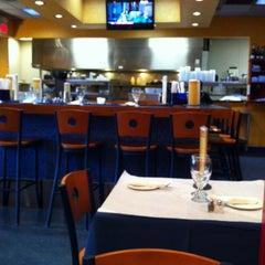 Photo taken at Rasoi Restaurant by Morena on 2/5/2013