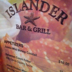 Photo taken at Islander Bar & Grill by Toninho T. on 5/19/2013