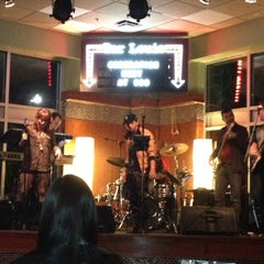 Photo taken at Bar Louie Orlando by Nicole Q. on 2/23/2013