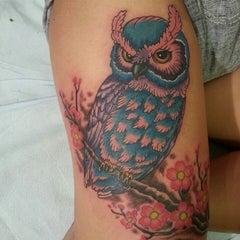 Photo taken at Rising Dragon Tattoos by Cat C. on 10/6/2013