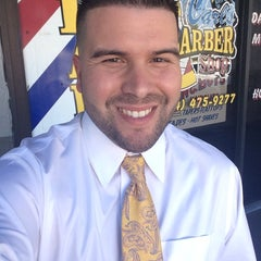 Photo taken at Carl's Barber Shop by Carlos G. on 2/18/2014