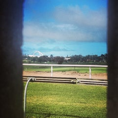 Photo taken at Greyville Racecourse by Avishkar S. on 1/10/2014