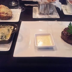 Photo taken at MetroPrime Steakhouse by Lindsay C. on 6/17/2013