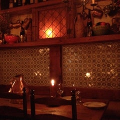 Photo taken at Convivium Osteria by Polina on 12/24/2012