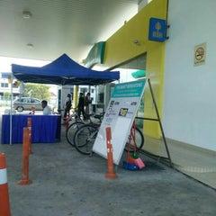 Photo taken at Petronas Bukit Beruntung by Honey M. on 6/20/2015