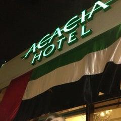 Photo taken at Acacia Hotel by Kat M. on 12/22/2012