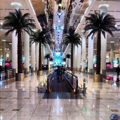 Photo taken at Abu Dhabi International Airport (AUH) مطار أبو ظبي الدولي by Richard C. on 2/12/2013
