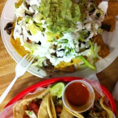 Photo taken at Tacos Lupita by Hali on 12/10/2012