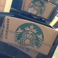 Photo taken at Starbucks by Eve on 2/6/2014