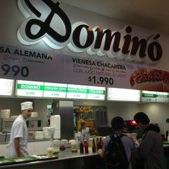 Photo taken at Dominó Plaza Antofagasta by Jocelyn G. on 8/13/2013