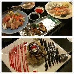 Photo taken at Sushi Dragon by Elizabeth M. on 4/25/2013