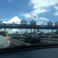 Photo taken at Fort McHenry Tunnel Toll Plaza by Ange N. on 7/4/2013