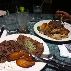 Photo taken at Mojitos Cuban Restaurant by Hector G on 10/19/2012