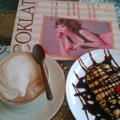 Photo taken at Coklat Cafe by Elvira H. on 5/26/2013