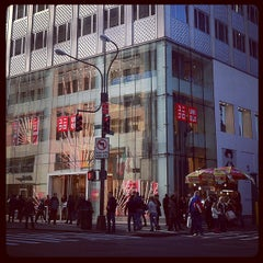 Photo taken at UNIQLO 5th Ave by Tai O. on 11/6/2011