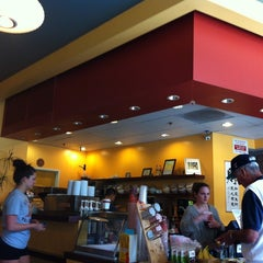 Photo taken at Infuzion Cafe by Jeannie N. on 5/4/2012