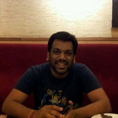 Photo taken at Nando's by Anuj S. on 10/13/2011