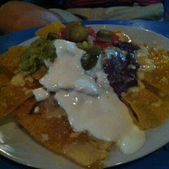 Photo taken at Mojo's Flying Burritos by Stephanie S. on 5/23/2012
