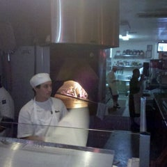 Photo taken at Bollini's Pizzeria Napolitana by Joe C. on 4/7/2012