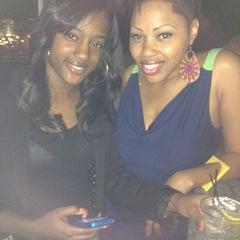 Photo taken at Indigo Bar & Lounge by Tay💇 S. on 3/17/2012